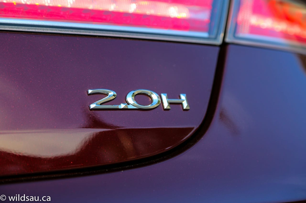 2.0H badge red